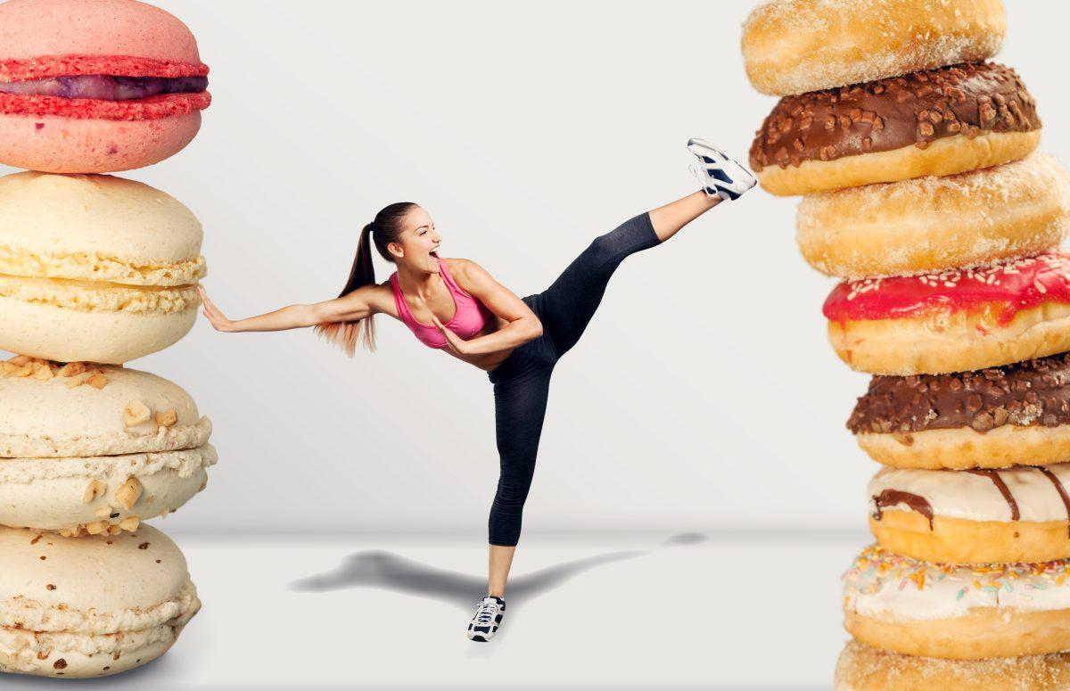 woman kicking oversized donuts
