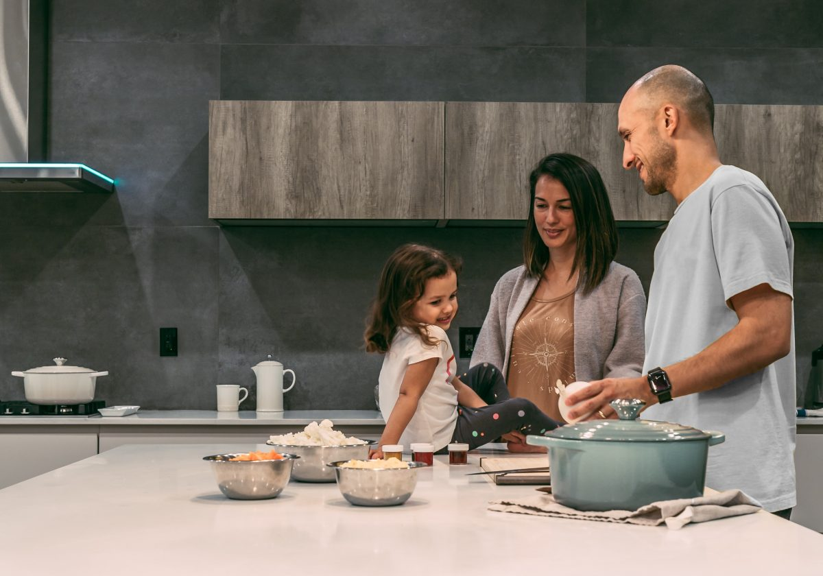 Mother, father, and child cooking in the kitchen