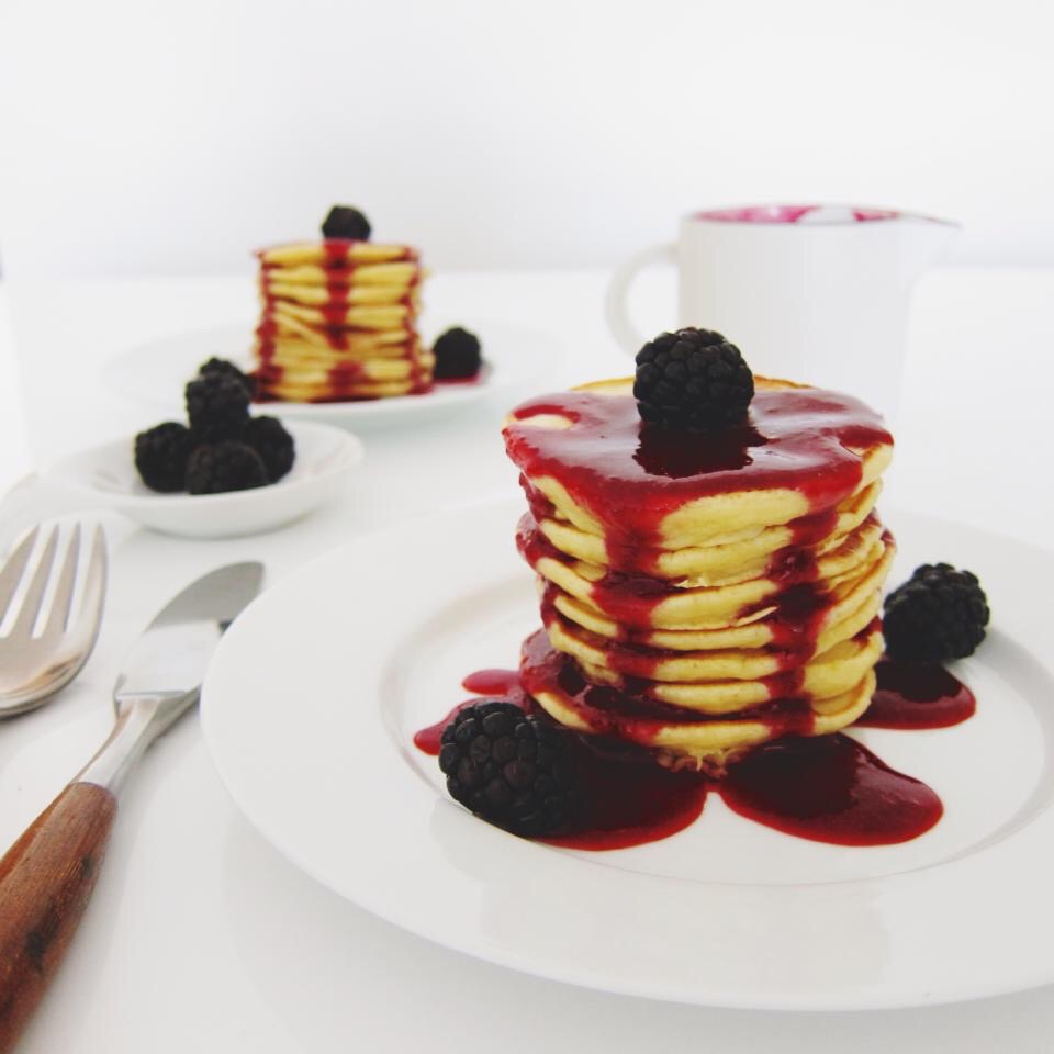 Healthy holiday breakfast - almond pancakes and berry sauce