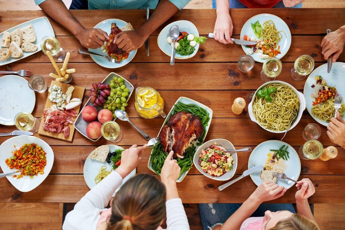 family around table eating thanksgiving dinner