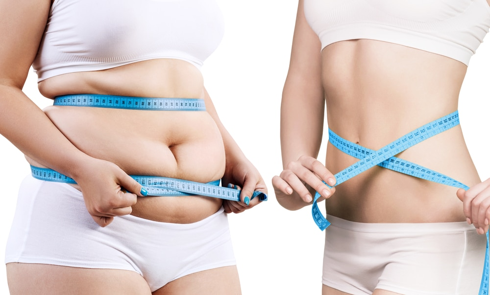 woman measuring stomach before and after weight loss